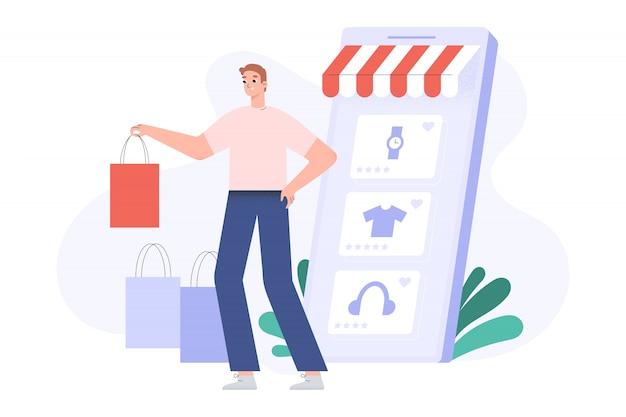 Piccolo giovane con borse della spesa e smartphone enorme, concetto di acquisto online