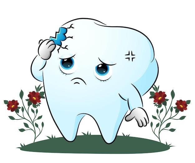 Il dente si sente male a causa del grande buco dell'illustrazione
