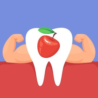 Dente con muscoli forti del braccio e una mela rossa il concetto di una sana alimentazione vegetariana adeguata