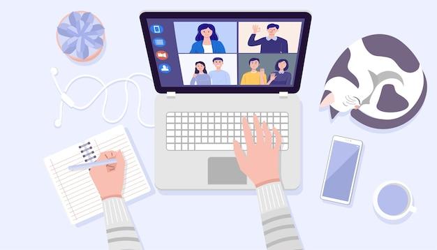 Vista dall'alto delle mani dell'uomo utilizzando laptop per videoconferenze a casa.
