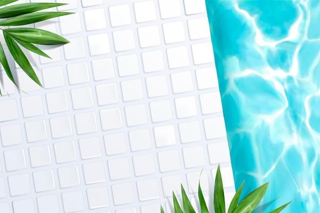 Vista dall'alto della scena della piscina con piastrelle bianche e foglie di palma verdi