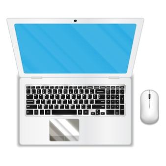 Vista dall'alto di laptop e mouse bianchi