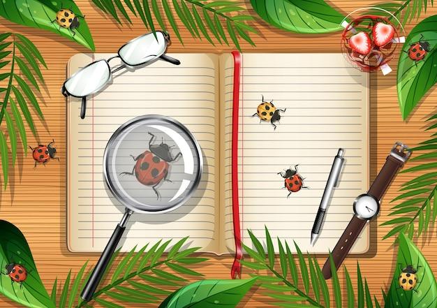 Vista dall'alto del tavolo in legno con oggetti per ufficio e foglie e elementi insetti