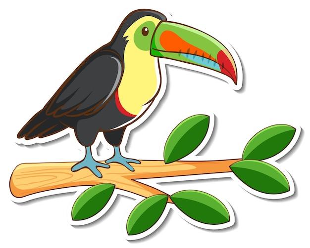 Un uccello tucano in piedi su un adesivo di ramo