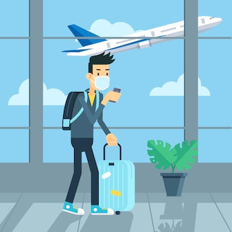 Turista che indossa la maschera in aeroporto a causa del coronavirus e del new normal
