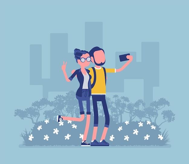 Turisti che si fanno selfie