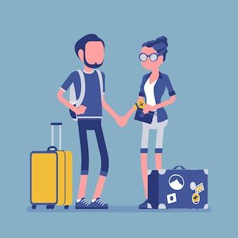 Turisti in tenuta da viaggio con bagagli e valigie