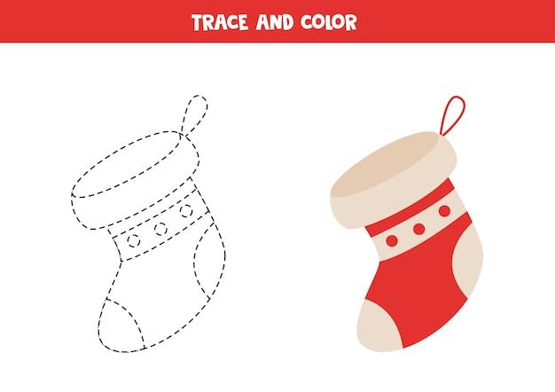 Traccia e colora il calzino di natale del fumetto. foglio di lavoro per bambini.
