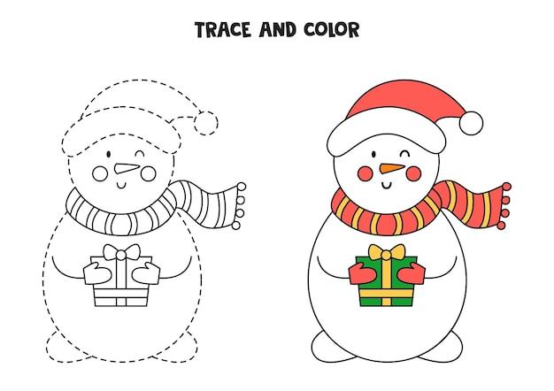 Traccia e colora un simpatico pupazzo di neve. foglio di lavoro per bambini.