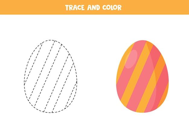 Traccia e colora il gioco educativo dell'uovo di pasqua per i bambini Vettore Premium