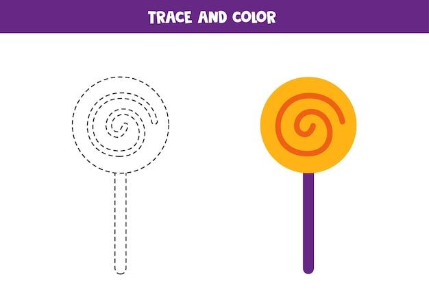 Traccia e colora il lecca-lecca di halloween. foglio di lavoro per bambini.