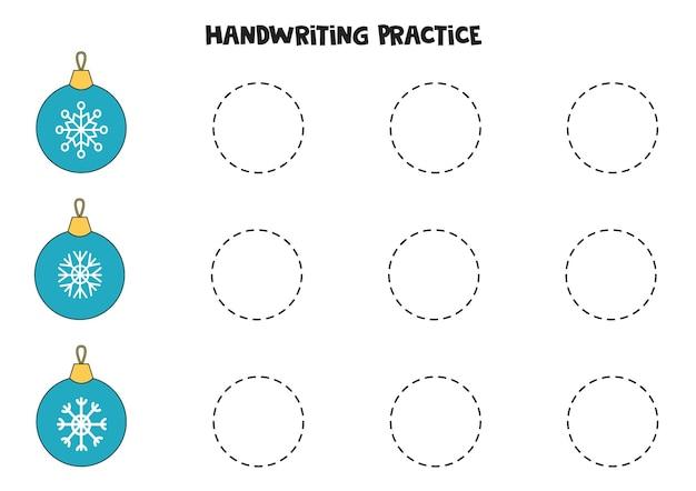 Tracciare le linee con le palle di natale dei cartoni animati. pratica di scrittura.