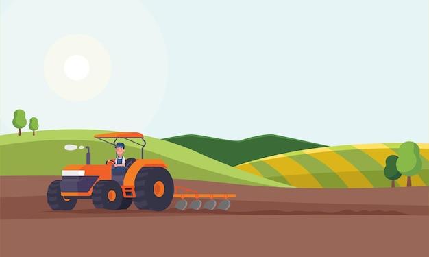 Trattore che ara un campo per piantare colture. agricoltura