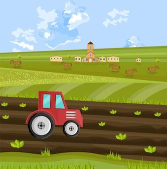 Trattore che lavora la terra alla fattoria