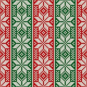 Modello tradizionale a maglia per le vacanze di natale con fiocchi di neve