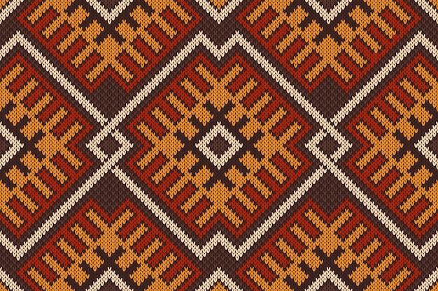 Modello senza cuciture azteco tribale tradizionale sulla trama a maglia di lana