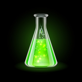 Boccetta trasparente con liquido verde magico su fondo nero.