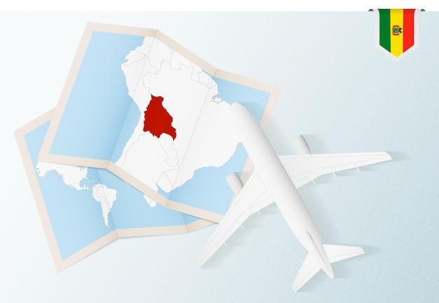 Viaggio in bolivia, aereo vista dall'alto con mappa e bandiera della bolivia.