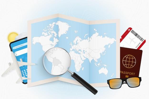 Destinazione di viaggio modello turistico della bolivia con attrezzatura da viaggio e mappa del mondo