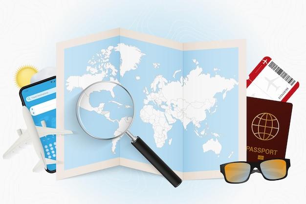 Destinazione di viaggio mockup turistico dell'honduras con attrezzatura da viaggio e mappa del mondo