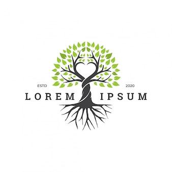 Concetto di logo dell'albero con elemento di amore.