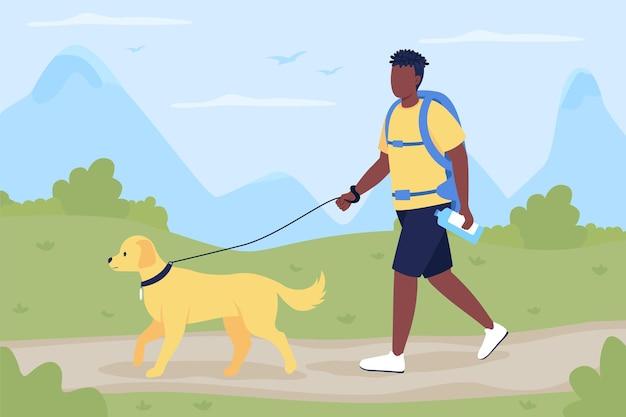 Trekker a piedi con il cane compagno piatto. uomo con il labrador che esplora il sentiero in campagna.