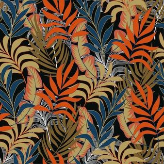Modello tropicale senza cuciture di tendenza con foglie e piante arancio e blu brillante