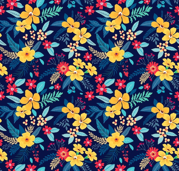 Motivo floreale senza soluzione di continuità alla moda con fiori esotici. fiori gialli su sfondo blu scuro. un bouquet di fiori primaverili per stampe di moda.