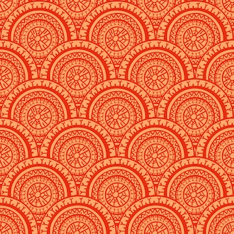 Modello rotondo rosso e arancio senza cuciture astratto bello tribale