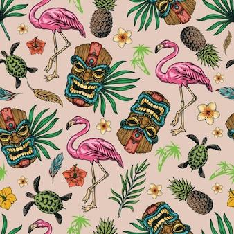 Modello senza cuciture colorato tropicale con fenicottero, tartaruga, ananas, maschera tiki, fiori, foglie e piume