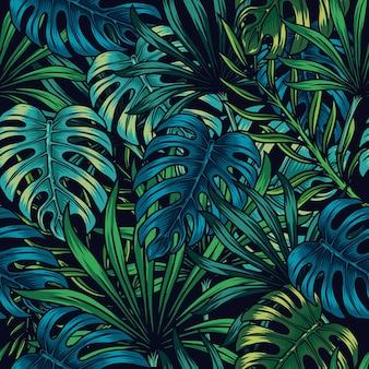 Motivo floreale tropicale senza soluzione di continuità con foglie di palma e monstera verdi