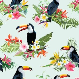 Fondo senza cuciture degli uccelli del tucano e dei fiori tropicali. motivo estivo retrò