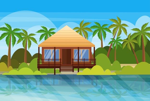 Isola tropicale villa bungalow hotel sulla spiaggia mare palme verdi paesaggio piatto vacanze estive