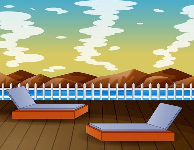 Un paesaggio tropicale con vista sulle montagne dell'oceano con lettini prendisole
