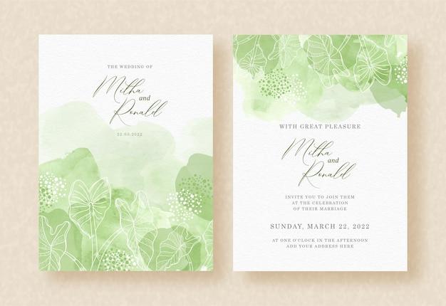 Foglie tropicali con pittura ad acquerello spruzzata astratta verde su invito a nozze