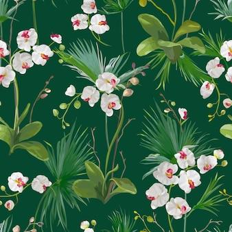 Foglie di palma tropicale e sfondo di fiori di orchidea. modello senza cuciture in