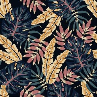 Modello tropicale senza soluzione di continuità foglie e piante tropicali colorate