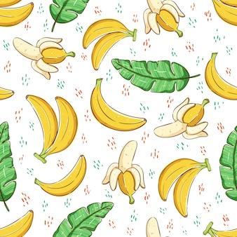 Concetto di estate tropicale nel modello senza cuciture frutta di banana e foglie di banana
