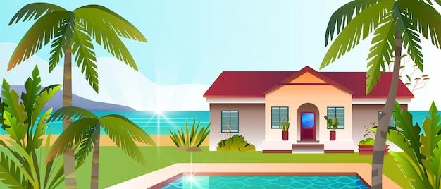 Vista tropicale con villa di lusso, piscina, cortile, palme, spiaggia, piante tropicali.