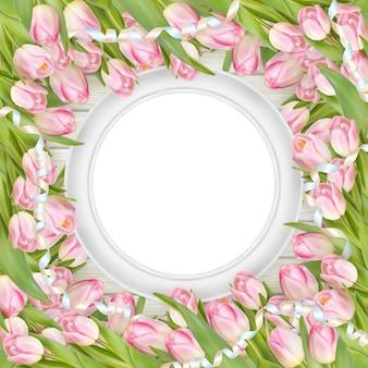 Tulipani e cornice bianca vuota.