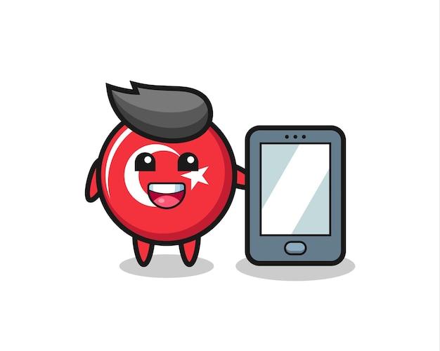 Fumetto dell'illustrazione del distintivo della bandiera della turchia che tiene uno smartphone, design in stile carino per maglietta, adesivo, elemento logo