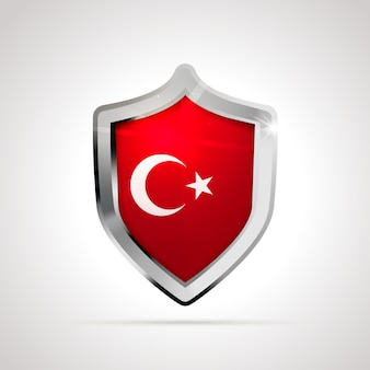 Bandiera della turchia proiettata come uno scudo lucido
