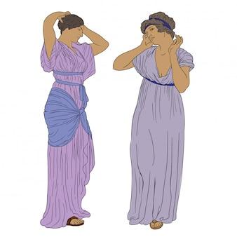Due antiche donne greche in tunica stanno in piedi e raddrizzano le loro acconciature.