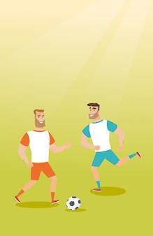 Due giocatori di calcio caucasici che combattono per una palla