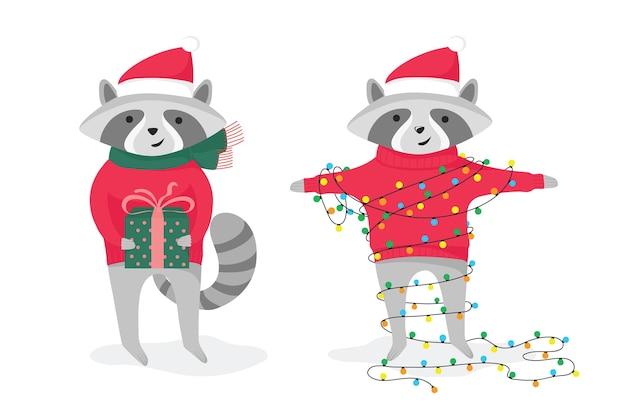 Due simpatici procioni natalizi con regalo e ghirlanda