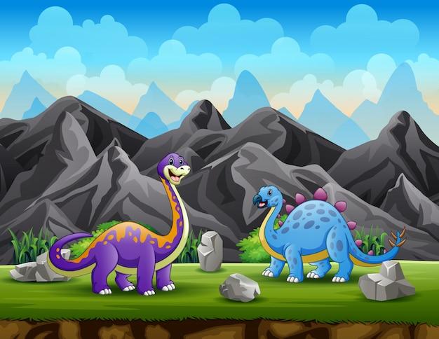 Due dinosauri sullo sfondo della scogliera di montagna