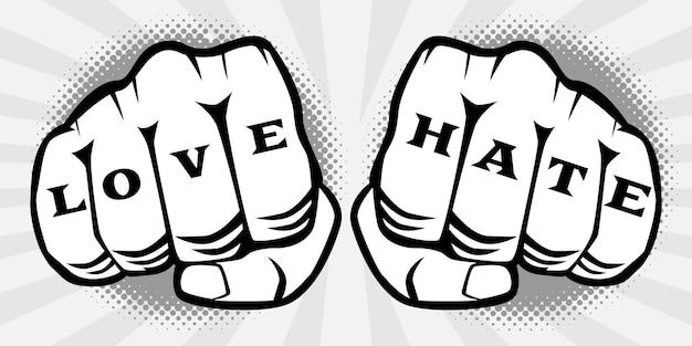 Due mani a pugno con amore odio tatuaggio sulle dita.