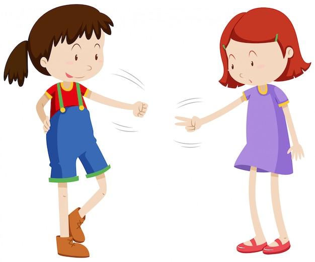 Due ragazze che giocano il rock di forbici di carta