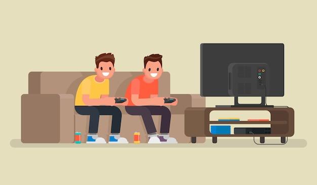 Due ragazzi giocano ai videogiochi sulla console di gioco. in uno stile piatto
