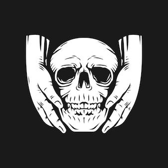 Due mani che portano il cranio. maglietta e disegno del tatuaggio.